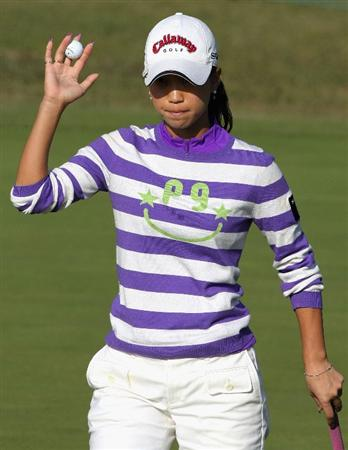 SHIMA, JAPAN - NOVEMBER 07:  Momoko Ueda of Japan waves her ball to the crowd on the 18th hole during the first round of 2008 Mizuno Classic at Kintetsu Kashikojima Country Club on November 7, 2008 in Shima, Mie, Japan.  (Photo by Koichi Kamoshida/Getty Images)