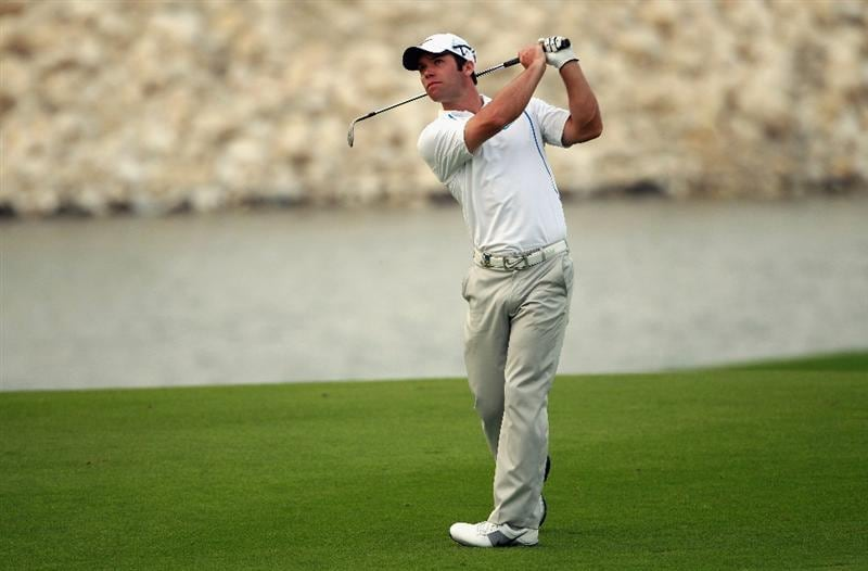 BAHRAIN, BAHRAIN - JANUARY 28:  Paul Casey of England plays his second shot on the 18th hole during the second round of the Volvo Golf Champions at The Royal Golf Club on January 28, 2011 in Bahrain, Bahrain.  (Photo by Andrew Redington/Getty Images)