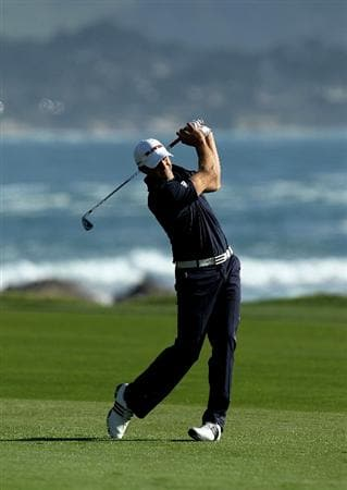 PEBBLE BEACH, CA - FEBRUARY 14:  Dustin Johnson hits his second shot on the 18th hole during the final round of the AT&T Pebble Beach National Pro-Am at Pebble Beach Golf Links on February 14, 2010 in Pebble Beach, California.  (Photo by Stephen Dunn/Getty Images)