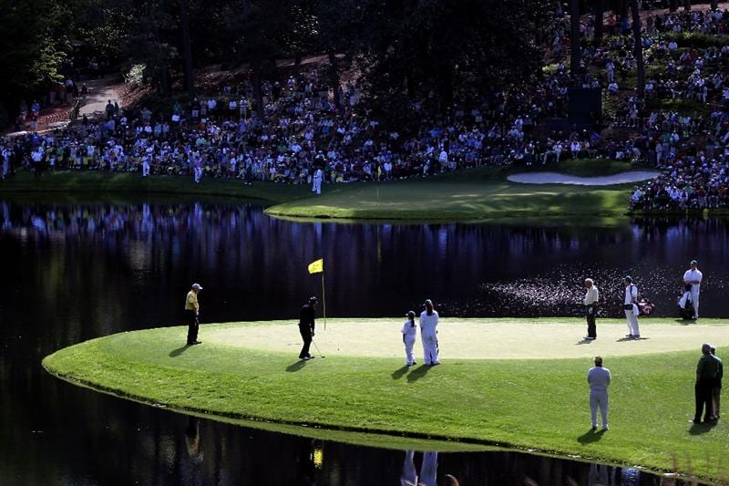 AUGUSTA, GA - APRIL 06:  Gary Player of South Africa (2nd L) putts while Jack Nicklaus (L) and Arnold Palmer (R) look on during the Par 3 Contest prior to the 2011 Masters Tournament at Augusta National Golf Club on April 6, 2011 in Augusta, Georgia.  (Photo by Jamie Squire/Getty Images)