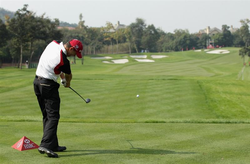 SHANGHAI, CHINA - NOVEMBER 04:  Padraig Harrington of Ireland hits his tee-shot on the third hole during the first round of the WGC-HSBC Champions at Sheshan International Golf Club on November 4, 2010 in Shanghai, China.  (Photo by Andrew Redington/Getty Images)