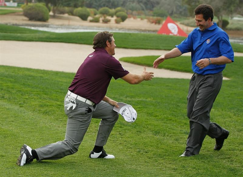 ABU DHABI, UNITED ARAB EMIRATES - JANUARY 18:  Lee Westwood of England (L) shakes hands with Jose Maria Olazabal of Spain, newly named 2012 European Ryder Cup Team Captain, during a practice round prior to the start of the 2011 Abu Dhabi HSBC Golf Championship  at the Abu Dhabi Golf Club on January 18, 2011 in Abu Dhabi, United Arab Emirates.  (Photo by Scott Halleran/Getty Images)