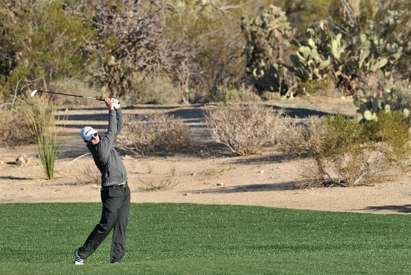 MARANA, AZ - FEBRUARY 24:  Justin Rose of England plays his approach on the second playoff  hole during the second round of the Accenture Match Play Championship at the Ritz-Carlton Golf Club on February 24, 2011 in Marana, Arizona.  (Photo by Stuart Franklin/Getty Images)