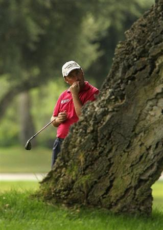 SOTOGRANDE, SPAIN - OCTOBER 29:  Damien McGrane of Ireland bits his nails while waiting to play from behind a tree on the 8th during the second round of the Andalucia Valderrama Masters at Club de Golf Valderrama on October 29, 2010 in Sotogrande, Spain.  (Photo by Richard Heathcote/Getty Images)