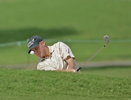 Jason Bohn takes a shot out of a greenside bunker on the 13th green during the third round of the PGA TOUR's Sony Open, January 14, 2006 at the Waialae Country Club in Honolulu, Hawaii.Photo by M. Garcia/WireImage.com