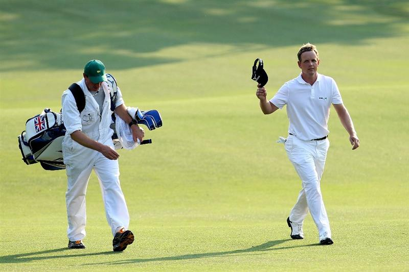AUGUSTA, GA - APRIL 10:  Luke Donald of England walks to the 18th green with his caddie John McLaren during the final round of the 2011 Masters Tournament at Augusta National Golf Club on April 10, 2011 in Augusta, Georgia.  (Photo by Andrew Redington/Getty Images)