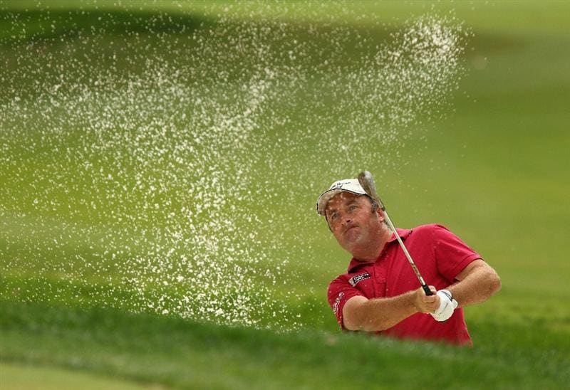 SOTOGRANDE, SPAIN - OCTOBER 29:  Damien McGrane of Ireland plays from a greenside bunker on the 8th during the second round of the Andalucia Valderrama Masters at Club de Golf Valderrama on October 29, 2010 in Sotogrande, Spain.  (Photo by Richard Heathcote/Getty Images)