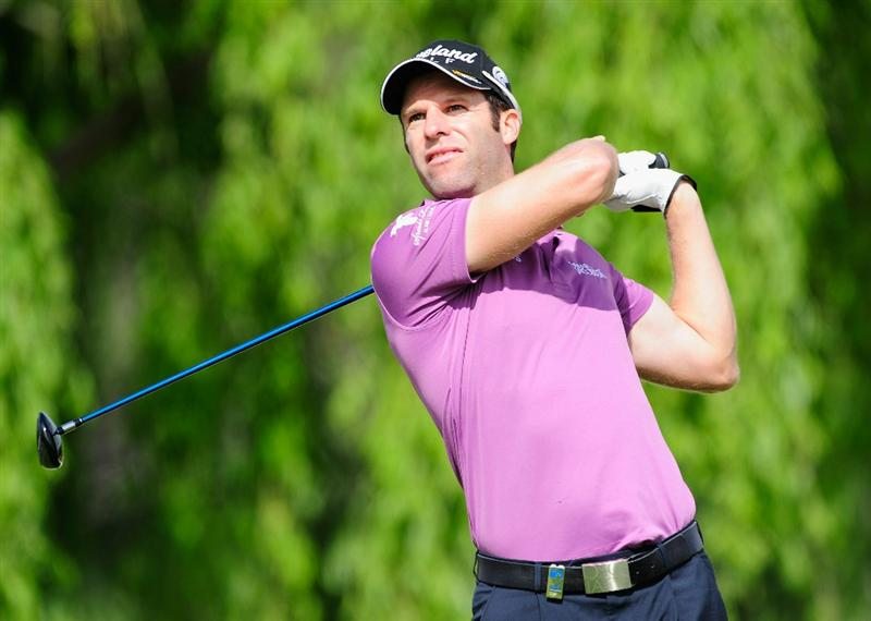 MADRID, SPAIN - MAY 28:  Bradley Dredge of Wales plays his tee shot on the 11th hole during the second round of the Madrid Masters at Real Sociedad Hipica Espanola Club De Campo on May 28, 2010 in Madrid, Spain.  (Photo by Stuart Franklin/Getty Images)