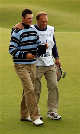 ST. ANDREWS, UNITED KINGDOM - OCTOBER 05: Martin Kaymer of Germany is consoled by his father Horst Kaymer after missing his birdie putt on the 18th green during the final round of The Alfred Dunhill Links Championship at The Old Course on October 5, 2008 in St.Andrews, Scotland.  (Photo by Andrew Redington/Getty Images)