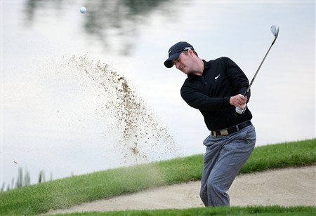 LIMERICK, IRELAND - MAY 16:  Marc Warren of Scotland plays his third shot on the par 18th hole during the second round of the Irish Open at Adare Manor on May 16, 2008 in Limercik, Ireland.  (Photo by Ross Kinnaird/Getty Images)