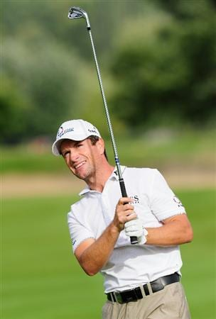 PARIS - SEPTEMBER 23:  Steve Webster of England plays his approach shot on the 15th hole during the first round of the Vivendi cup at Golf de Joyenval on September 22, 2010 in Chambourcy, near Paris, France.  (Photo by Stuart Franklin/Getty Images)