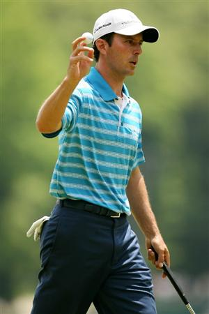 FARMINGDALE, NY - JUNE 19:  Mike Weir of Canada celebrates a birdie putt on the 15th hole during the continuation of the first round of the 109th U.S. Open on the Black Course at Bethpage State Park on June 19, 2009 in Farmingdale, New York.  (Photo by Andy Lyons/Getty Images)