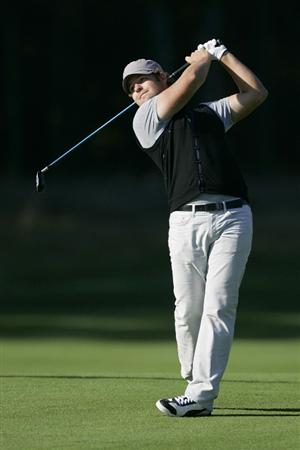 NORTON, MA - SEPTEMBER 04:  Ryan Moore of the United States plays a shot from the fairway during the first round of the Deutche Bank Championship at TPC Boston held on September 4, 2009 in Norton, Massachusetts.  (Photo by Michael Cohen/Getty Images)