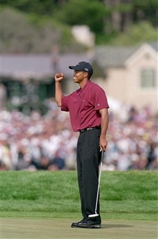 PEBBLE BEACH - JUNE 18: Tiger Woods smiles as he celebrates his final putt during the 100th US Open at the Pebble Beach Golf Links on June 18,2000 in Pebble Beach, California. (Photo by: Jamie Squire/Getty Images)