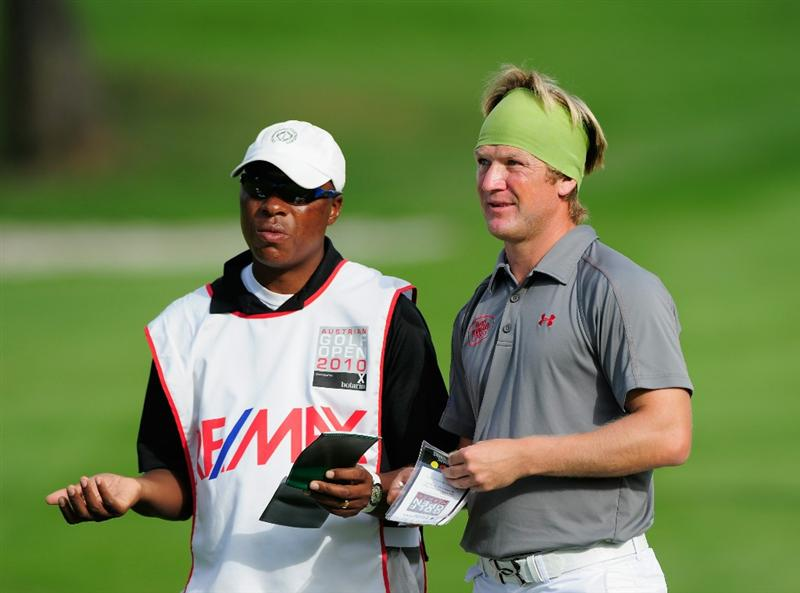 VIENNA, AUSTRIA - SEPTEMBER 18:  Pelle Edberg of Sweden and caddie discuss his approach shot on the 17th hole during the third round of the Austrian golf open presented by Botarin at the Diamond country club on September 18, 2010 in Atzenbrugg near Vienna, Austria.  (Photo by Stuart Franklin/Getty Images)