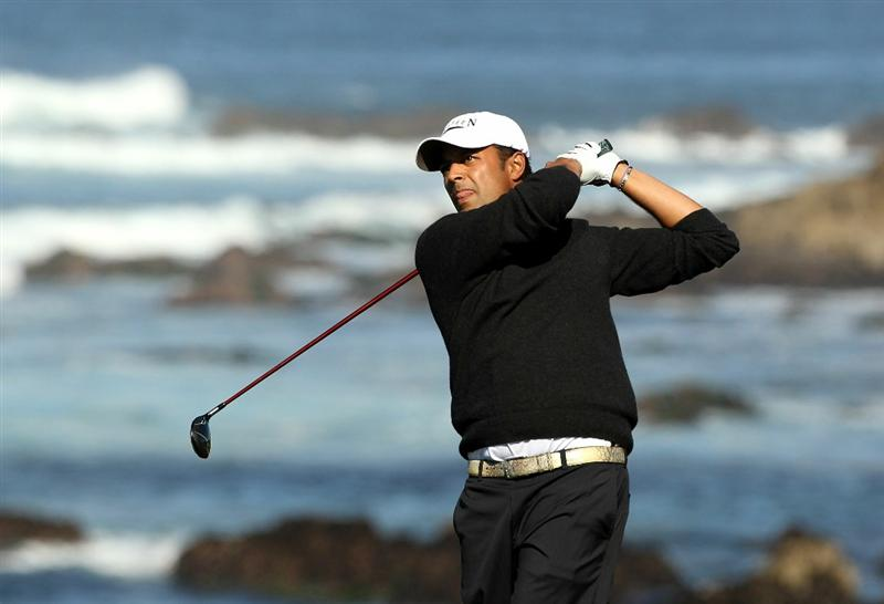 PEBBLE BEACH, CA - FEBRUARY 11:  Arjun Atwal of India tees off on the 13th hole during the second round of the AT&T Pebble Beach National Pro-Am at Monterey Peninsula Country Club on February 11, 2011 in Pebble Beach, California.  (Photo by Ezra Shaw/Getty Images)