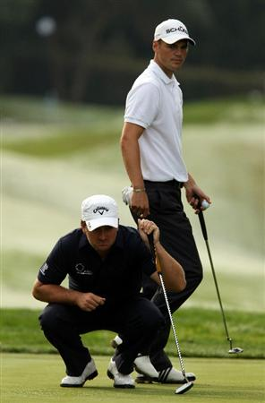 SOTOGRANDE, SPAIN - OCTOBER 28:  Graeme McDowell of Northern Ireland and Martin Kaymer of Germany line up putts on the 3rd green during the first round of the Andalucia Valderrama Masters at Club de Golf Valderrama on October 28, 2010 in Sotogrande, Spain.  (Photo by Richard Heathcote/Getty Images)
