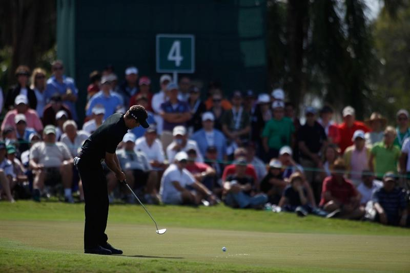 DORAL, FL - MARCH 14:  Charl Schwartzel of South Africa putting on the fourth hole during the final round of the 2010 WGC-CA Championship at the TPC Blue Monster at Doral on March 14, 2010 in Doral, Florida.  (Photo by Marc Serota/Getty Images)