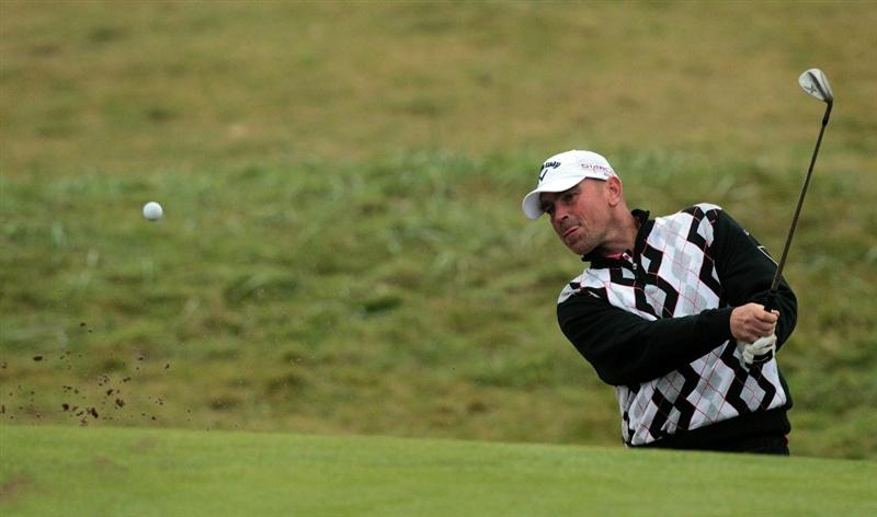 CARNOUSTIE, SCOTLAND - OCTOBER 08:  Thomas Bjorn of Denmark playing his third shot at the 6th hole during the second round of The Alfred Dunhill Links Championship at Carnoustie Golf Links on October 8, 2010 in Carnoustie, Scotland.  (Photo by David Cannon/Getty Images)