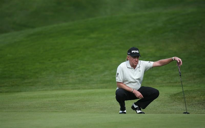 CRANS, SWITZERLAND - SEPTEMBER 04:  Miguel Angel Jimenez of Spain lines up a putt on the 14th green during the third round of The Omega European Masters at Crans-Sur-Sierre Golf Club on September 4, 2010 in Crans Montana, Switzerland.  (Photo by Warren Little/Getty Images)