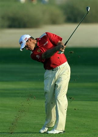 DUBAI, UNITED ARAB EMIRATES - FEBRUARY 10:  Lee Westwood of England plays his second shot to the 16th hole during the first round of the 2011 Omega Dubai Desert Classic on the Majilis Course at the Emirates Golf Club on February 10, 2011 in Dubai, United Arab Emirates.  (Photo by David Cannon/Getty Images)