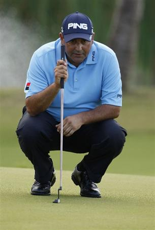 RIO GRANDE, PR - MARCH 10: Angel Cabrera of Argentina lines up a putt during the first round of the Puerto Rico Open presented by seepuertorico.com at Trump International Golf Club on March 10, 2011 in Rio Grande, Puerto Rico.  (Photo by Michael Cohen/Getty Images)