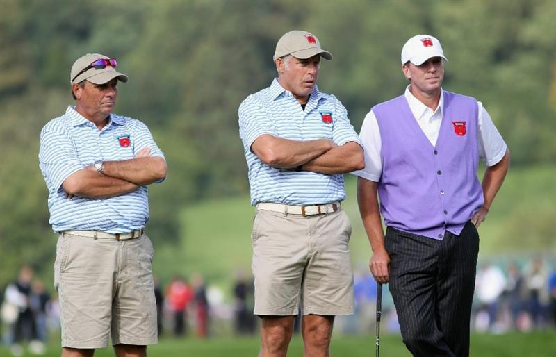 NEWPORT, WALES - OCTOBER 02:  USA Team caddies Jimmy Johnson (L) and Steve Williams (C) wait alongside Steve Stricker during the rescheduled Afternoon Foursome Matches during the 2010 Ryder Cup at the Celtic Manor Resort on October 2, 2010 in Newport, Wales.  (Photo by Jamie Squire/Getty Images)