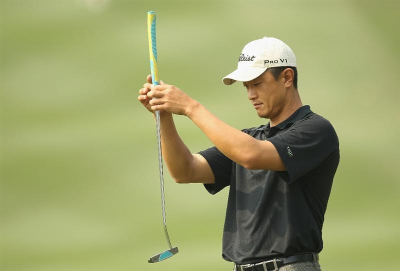 HONG KONG - NOVEMBER 19:  Anthony Kang of the USA lines up a put during day two of the UBS Hong Kong Open at The Hong Kong Golf Club on November 19, 2010 in Hong Kong, Hong Kong.  (Photo by Ian Walton/Getty Images)