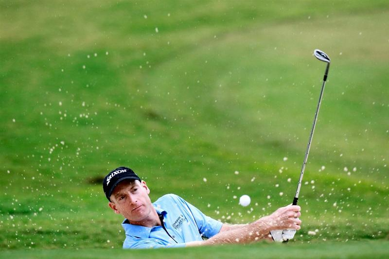 ATLANTA - SEPTEMBER 26:  Jim Furyk hits from a bunker on the 12th hole during the final round of THE TOUR Championship presented by Coca-Cola at East Lake Golf Club on September 26, 2010 in Atlanta, Georgia.  (Photo by Kevin C. Cox/Getty Images)