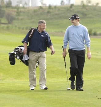 Scott Drummond talks to his caddie during a practice round for the 2005 Algarve World Cup at the Victoria Golf Club in Vilamoura, Portugal on November 15, 2005.Photo by Sandy Young/WireImage.com