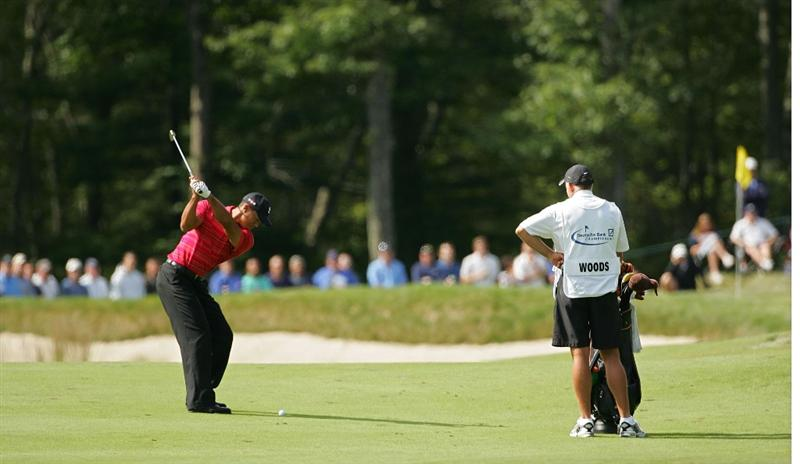 NORTON, MA - SEPTEMBER 07:  Tiger Woods hits hs second shot on the first hole during the final round of the Deutsche Bank Championship at TPC Boston held on September 7, 2009 in Norton, Massachusetts.  (Photo by Michael Cohen/Getty Images)