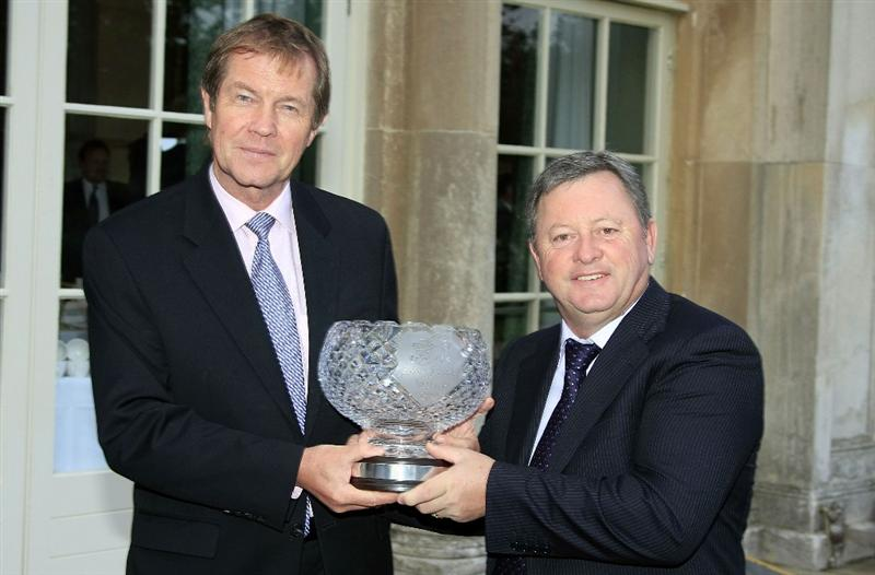 WOBURN, ENGLAND - SEPTEMBER 04:  Ian Woosnam of Wales receives from George O'Grady, Chief Executive of the European Tour, The John Jacobs Trophy for Winning the Order of Merit at the Annual Awards Dinner held at Woburn Abbey prior to the first round of the Travis Perkins plc Senior Masters played at The Duke's Course, Woburn Golf Club on September 3, 2009 in Woburn, United Kingdom  (Photo by Phil Inglis/Getty Images)