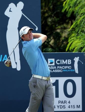 KUALA LUMPUR, MALAYSIA - OCTOBER 31: Martin  Laird of Scotland tees off on the 10th holeduring day four of the CIMB Asia Pacific Classic at The MINES Resort & Golf Club on October 31, 2010 in Kuala Lumpur, Malaysia. (Photo by Stanley Chou/Getty Images)