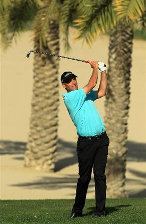 DUBAI, UNITED ARAB EMIRATES - FEBRUARY 13:  Anders Hansen of Denmark plays his second shot at the 14th hole during the final round of the 2011 Omega Dubai Desert Classic on the Majilis Course at the Emirates Golf Club on February 13, 2011 in Dubai, United Arab Emirates.  (Photo by David Cannon/Getty Images)