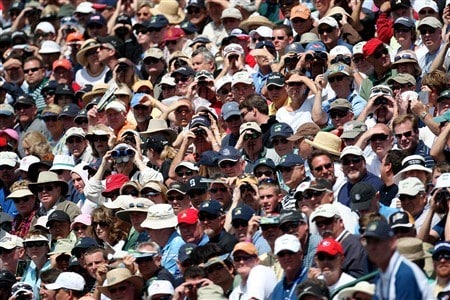 SAN DIEGO - JUNE 12:  A large gallery watches the play of the grouping of Tiger Woods, Phil Mickelson and Adam Scott during the first round of the 108th U.S. Open at the Torrey Pines Golf Course (South Course) on June 12, 2008 in San Diego, California.  (Photo by Ross Kinnaird/Getty Images)