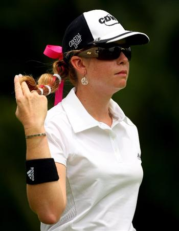 SINGAPORE - MARCH 07:  Paula Creamer of the USA plays with her hair on the sixth hole during the third round of the HSBC Women's Champions at Tanah Merah Country Club on March 7, 2009 in Singapore.  (Photo by Andrew Redington/Getty Images)