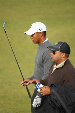 TURNBERRY, SCOTLAND - JULY 14:  Tiger Woods of USA walks alongside Mike Tirico of ABC Sports during a practice round prior to the 138th Open Championship on the Ailsa Course, Turnberry Golf Club on July 14, 2009 in Turnberry, Scotland.  (Photo by Warren Little/Getty Images)