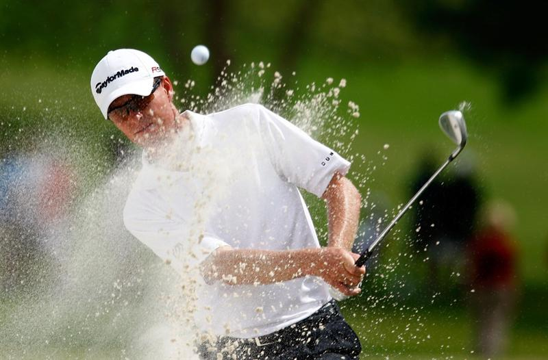ATLANTA - SEPTEMBER 25:  John Senden of Australia plays a bunker shot on the first hole during the second round of THE TOUR Championship presented by Coca-Cola, the final event of the PGA TOUR Playoffs for the FedEx Cup, at East Lake Golf Club on September 25, 2009 in Atlanta, Georgia.  (Photo by Scott Halleran/Getty Images)