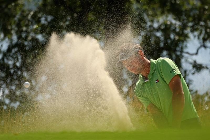 LUSS, SCOTLAND - JULY 10:  Nick Dougherty of England hits out of a bunker on to the 7th green during the Second Round of The Barclays Scottish Open at Loch Lomond Golf Club on July 10, 2009 in Luss, Scotland.  (Photo by Warren Little/Getty Images)