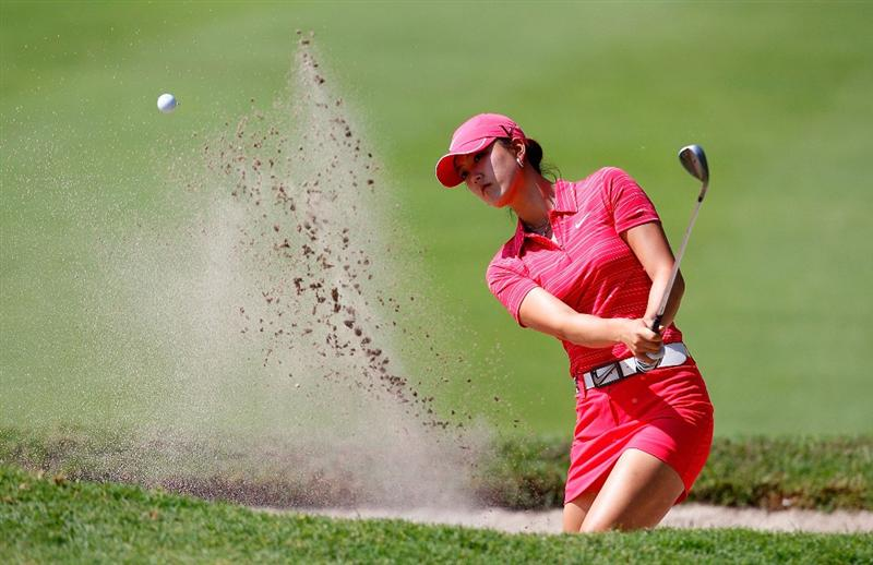 GUADALAJARA, MEXICO - NOVEMBER 15:  Michelle Wie of the United States hits out of the sand onto the third green during the final round of the Lorena Ochoa Invitational Presented by Banamex and Corona at Guadalajara Country Club on November 15, 2009 in Guadalajara, Mexico.  (Photo by Kevin C. Cox/Getty Images)