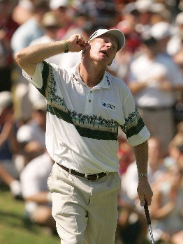 TULSA, OK - AUGUST 12:  Woody Austin clowns around with the gallery after his birdie putt on the 12th green during the final round of the 89th PGA Championship at the Southern Hills Country Club on August 12, 2007 in Tulsa, Oklahoma.  (Photo by Streeter Lecka/Getty Images)