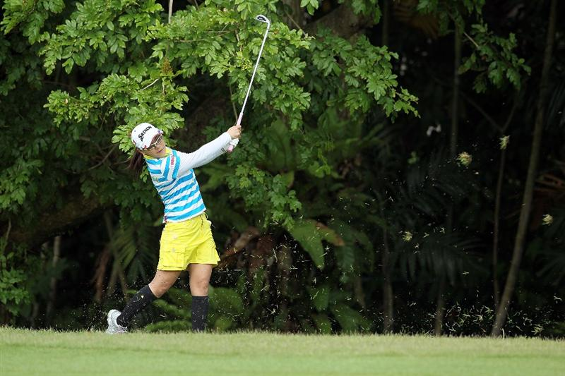 SINGAPORE - FEBRUARY 28:  Sakura Yokomine of Japan hits her second shot on the 4th hole during the final round of the HSBC Women's Champions at Tanah Merah Country Club on February 28, 2010 in Singapore, Singapore.  (Photo by Andy Lyons/Getty Images)