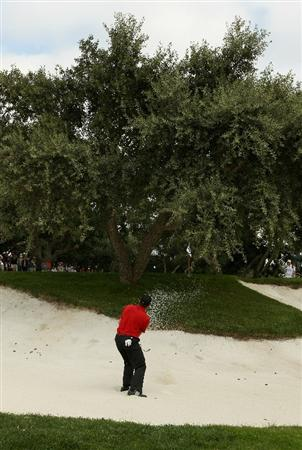 SOTOGRANDE, SPAIN - OCTOBER 29:  Sergio Garcia of Spain tries to play a bunker shot between the trunks of a tree around the 5th green during the second round of the Andalucia Valderrama Masters at Club de Golf Valderrama on October 29, 2010 in Sotogrande, Spain.  (Photo by Richard Heathcote/Getty Images)