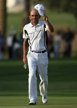 DOHA, QATAR - FEBRUARY 05:  Markus Brier of Austria waves to the crowd on the 18th hole during the third round of the Commercialbank Qatar Masters held at Doha Golf Club on February 5, 2011 in Doha, Qatar.  (Photo by Andrew Redington/Getty Images)