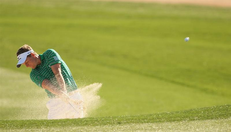 MARANA, AZ - FEBRUARY 18:  Luke Donald of England plays his second shot on the second hole during round two of the Accenture Match Play Championship at the Ritz-Carlton Golf Club on February 18, 2010 in Marana, Arizona.  (Photo by Darren Carroll/Getty Images)
