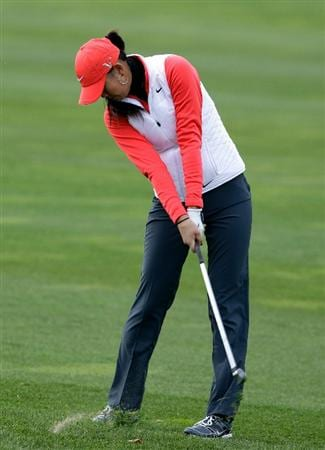 INCHEON, SOUTH KOREA - OCTOBER 31:  Michelle Wie of United States hits a shot out of the rough on the second hole during the 2010 LPGA Hana Bank Championship at Sky 72 Golf Club on October 31, 2010 in Incheon, South Korea.  (Photo by Chung Sung-Jun/Getty Images)