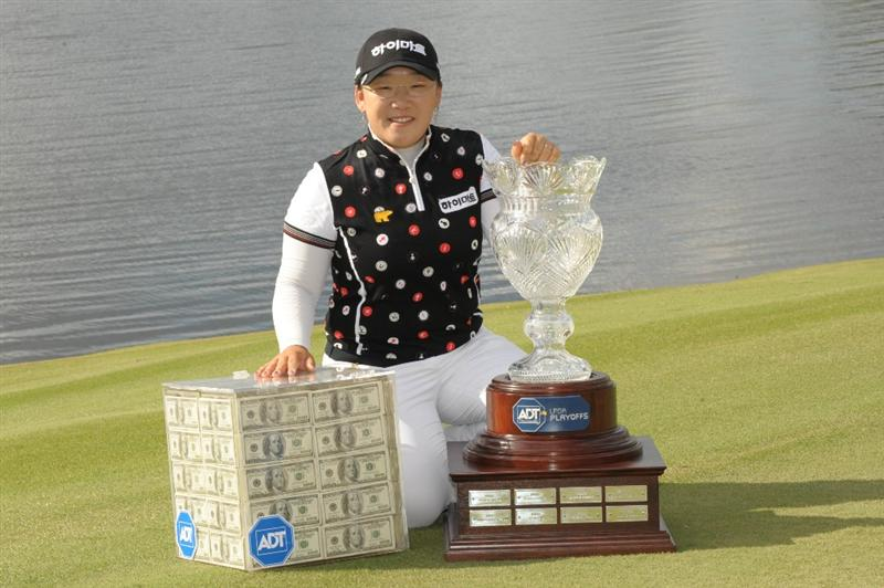 WEST PALM BECH, FL - NOVEMBER 23:  Ji-Yai Shin poses with the million dollar prize and trophy after a one-stroke victory at the ADT Championship at the Trump International Golf Club on November 23, 2008 in West Palm Beach Florida.  (Photo by Montana Pritchard/Getty Images)