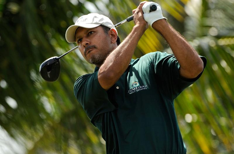 DORAL, FL - MARCH 14:  Jeev M. Singh of India hits a shot on the 3rd hole during the third round of the World Golf Championships-CA Championship at the Doral Golf Resort & Spa on March 14, 2009 in Doral, Florida.  (Photo by Sam Greenwood/Getty Images)