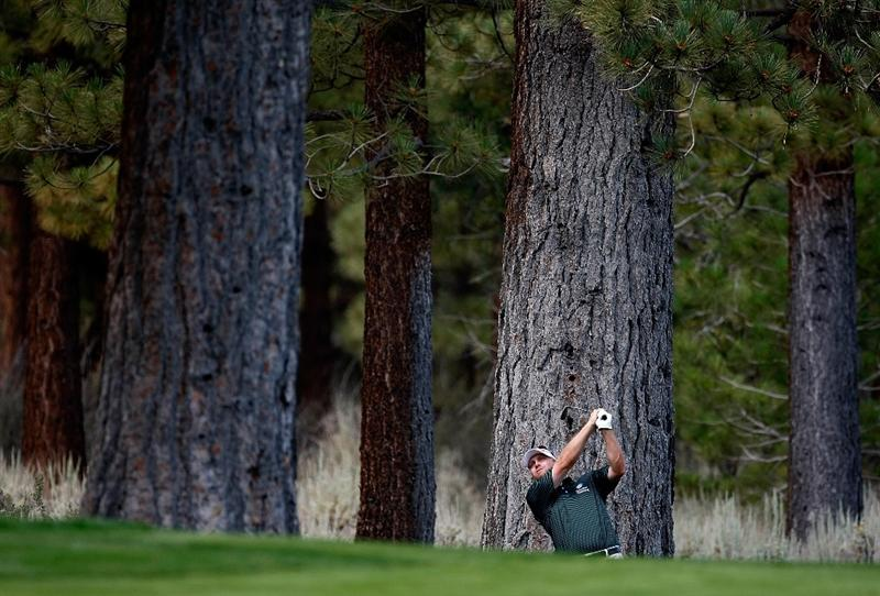 RENO, NV - AUGUST 09:  John Rollins hits out of the trees on the fourth hole during the final round of the Legends Reno-Tahoe Open on August 9, 2009 at Montreux Golf and Country Club in Reno, Nevada.  (Photo by Jonathan Ferrey/Getty Images)