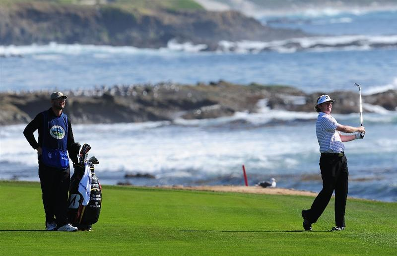 PEBBLE BEACH, CA - FEBRUARY 12:  Brandt Snedeker plays a shot on the 18th hole during round two of the AT&T Pebble Beach National Pro-Am at Pebble Beach Golf Links on February 12, 2010 in Pebble Beach, California.  (Photo by Stuart Franklin/Getty Images)